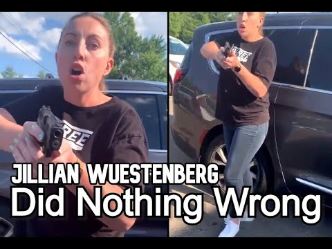 White Woman pulls gun on Belligerent black family Trying to Attack Her